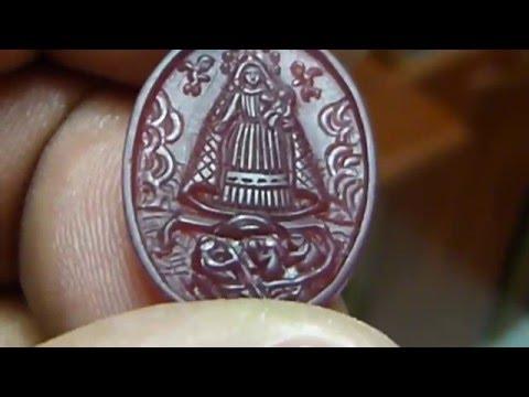Medalla de la Virgen de la caridad del cobre.
