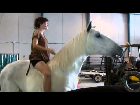 Sexy bored girl rides a mechanical horse