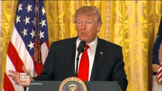 Scorning media, Trump denies reports of chaos during wide-ranging news conference