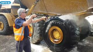 Touchlesly cleaning a dump truck