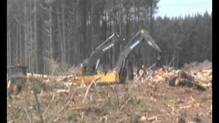 Two volvo grapple diggers working together