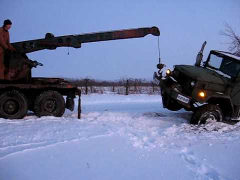 M108 trying to lift M35 out of ditch