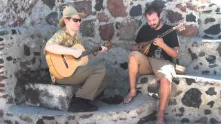 Playing a fisherman's song in Oia, Greece