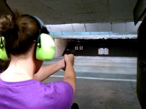 Jenn firing a Glock 45 full size at On Target