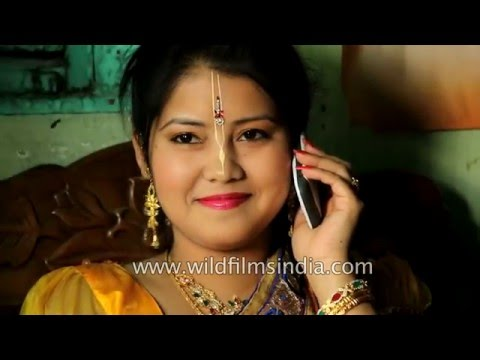 Manipuri bride speaks to friends on her mobile, before her wedding