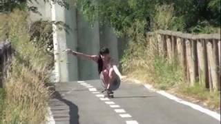 Cute Girl Skateboarding in Skirt.