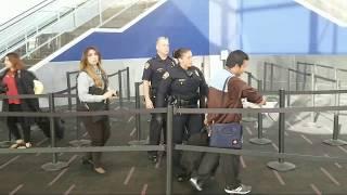 man tries to run pass tsa checkpoint lax airport police at work at Los Angeles International Airport