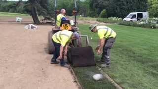 Maydencroft contracting team laying big roll turf