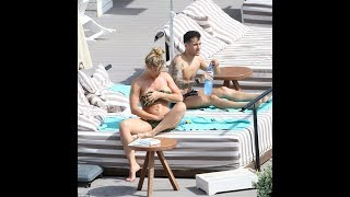 Gemma Atkinson grapples in a skimpy keyhole bikini joined Gorka Marquez in Ibiza