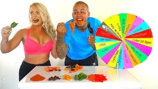Mystery Wheel of WORLD'S HOTTEST PEPPERS Challenge! * GHOST PEPPERS * CAROLINA REAPERS * HOT CHEETOS