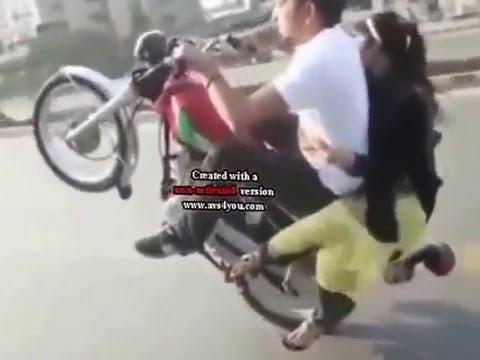 Mad Boy and Girl on a bike Dangerous wheeling