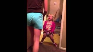 Super baby girl tries to pee like a boy