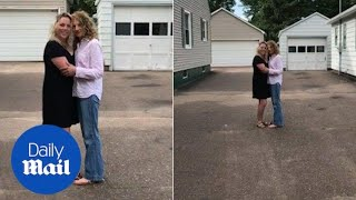 Heart-warming moment long lost sisters embrace after being reunited - Daily Mail