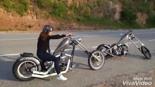 Girl kickstarts a Evolution Harley Davidson