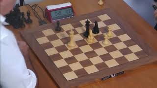 Nervous Kasparov battling with 1 sec left in his clock and has two connected center passed pawn