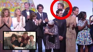 Guy walks on stage with winners Palm d'Or Award @ Cannes Film Festival 2015