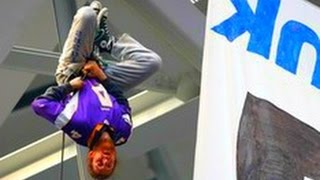 protesters at Vikings game  hanging from the stadium roof