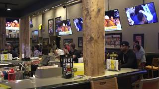 A group of fans at Buffalo Wild Wings in downtown Cleveland show their excitement over Jabrill Peppe