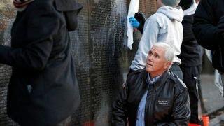 Pence helps clean Vietnam Veterans Memorial