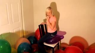 pops balloons by sitting on them -