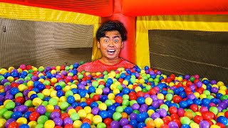 I Filled a Bouncy House with 10,000 Ball Pits!