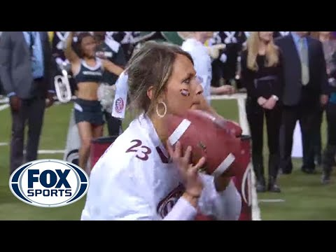 Girl wins 100 000 throwing football with two hands