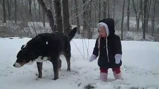 cutest little girl enjoying her first snow.