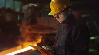 Engineer in Glasses using Tablet PC in Foundry | Stock Footage