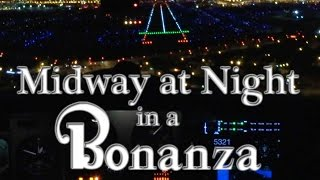 Midway at Night in a Bonanza