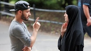 شاب يظرب فتاة مسلمة في الشارع شاهد ردة فعل الناس