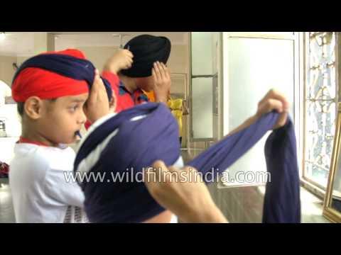 Young Sikh boys learn to tie a Turban at Shri Singh Sabha Gurudwara