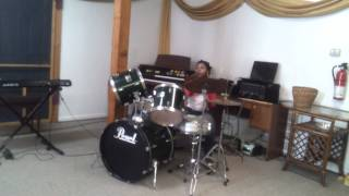 Malazia mosley is playing the drums in church