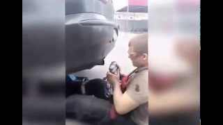 Crazy russian mechanic puts his face in car exhaust