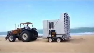 Trator Puxando Paredão na Praia
