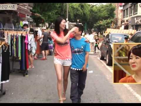 Tall Girl Short Boyfriend Walking on the Street