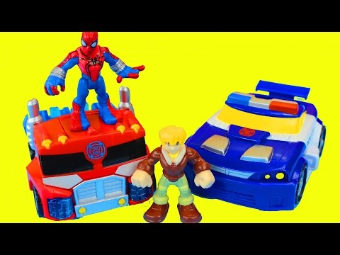 Transformers Rescue Bots Optimus Prime and Spider Man Battle Imaginext Dinosaur Playskool