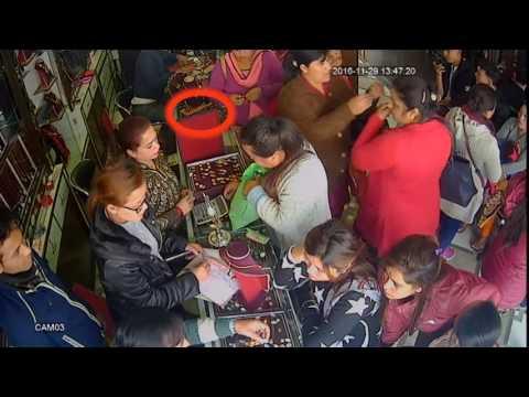 Women theft gold chain in Akarshak Jwellery Pokhara