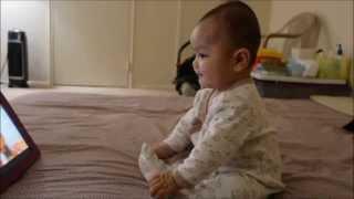 Baby watching elmo duck song