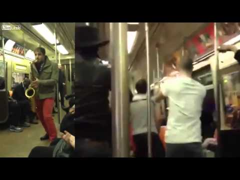Two Total Strangers Have Saxophone Battle On NYC Subway Train