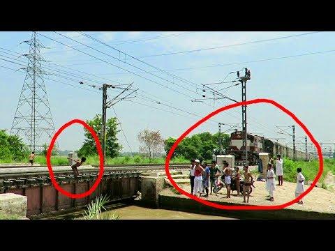 Xxx Mp4 Dangerous Stunt Kids Risking Their Life Jumps Into Canal Infront Of Speeding Garib Rath Express 3gp Sex