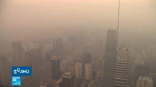 """...""""التنين الأصفر"""" يعصف بصحراء الصين ويتسبب في تهجير سكا"""