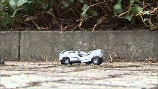 Destroy some toy cars with a stone in slowmotion - Auto mit Stein zerstören
