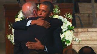 Obama hugs, kisses Biden after eulogy
