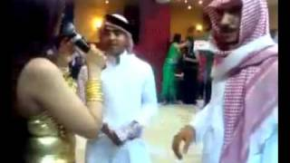 Saudi guy throws a lot of money over Iraqi belly dancer!