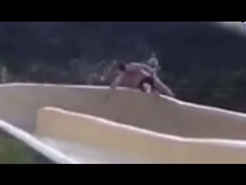 Man Flies Off Water Slide Down Rocky Cliff CAUGHT ON TAPE