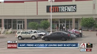 Two women charged after baby left in hot car