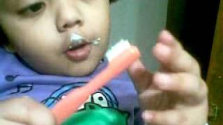 Bangla kid funny video - baby girl brushing teeth herself for the first time 14012011