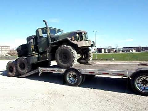 M818 Military Truck being loaded onto a trailer to go to Florida