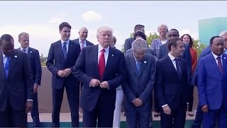 Trump holds off on climate change pact as overseas trip ends