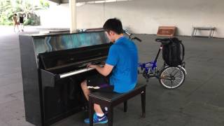 itravelbold.com- Playing Piano outside MBS Singapore